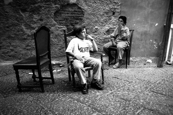 Two boys seated on the street in Naples, Italy 1988