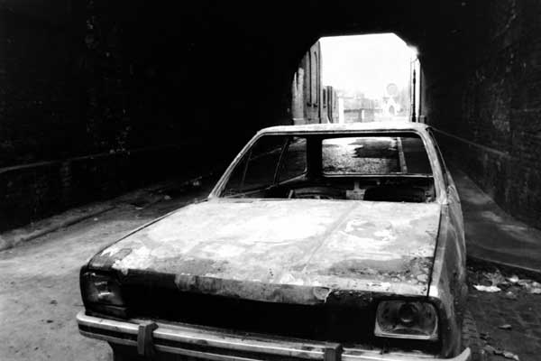 Abandoned & burnt out car, Spitalfields c. 1997