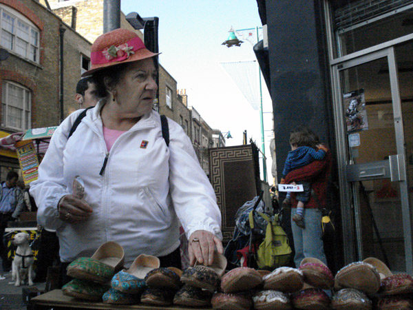 A woman selling shoes. Brick Lane Market 2006