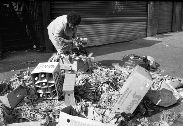 Collecting discarded vegetables. Spitalfields market c.1990