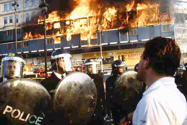 Police face demonstrators in Trafalgar Square at Poll Tax demo 1990
