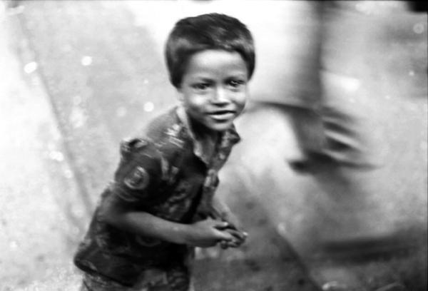 Child running next to train in Sylhet, Bangladesh 1994