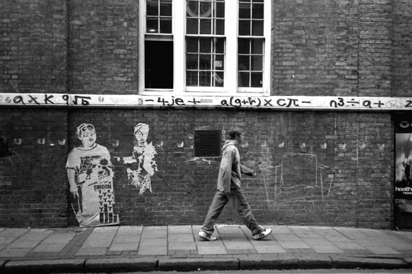 Images fixed to the wall, Brick Lane 1999