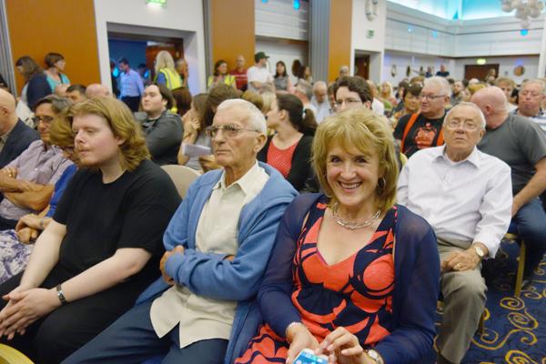 Audience members at the meeting