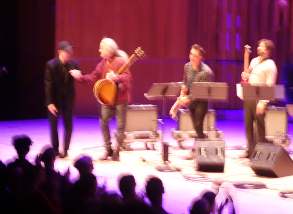 Steve Reich congratulates the lead guitarist following the performance of