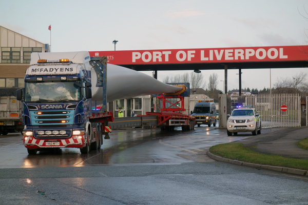 A lorry carrying a wind turbine blade emerges from the Port of Liverpool 2017