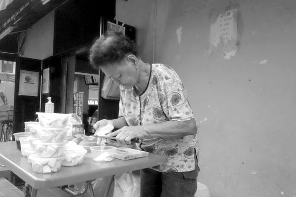 Preparing food for sale. Melaka 2015