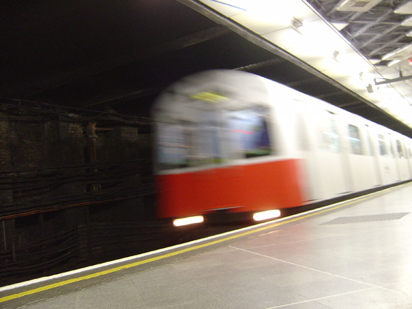 London Underground train arrives at a station 2004