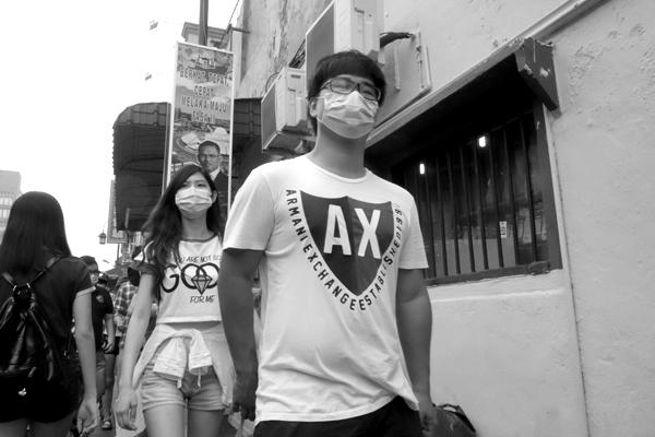Wearing pollution masks, Melaka 2015