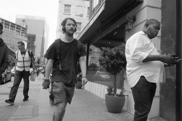 Man with headphones, Whitechapel 2015