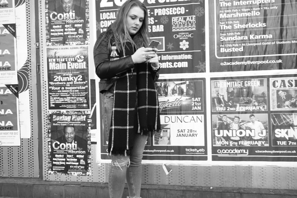 Looking at a mobile. Lime Street, Liverpool 2017