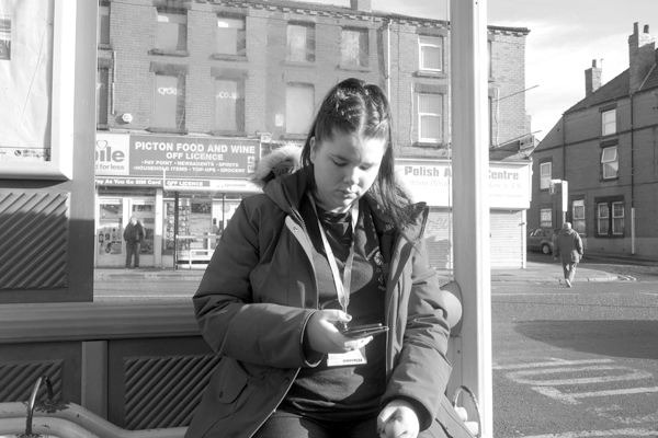 Waiting for a bus on Picton Road. Liverpool March 2017.
