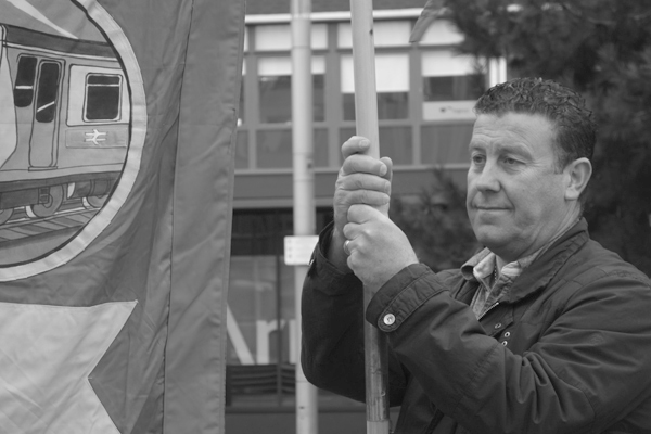 A member of the RMT. Demonstration in support of Martin Zee. Derby Square. Liverpool March 2017.