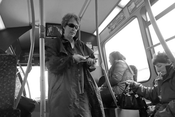 Woman with sun glasses on a bus. Liverpool 2016