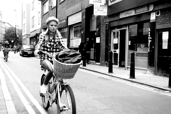 Woman on bike. Whitechapel, London 2015.