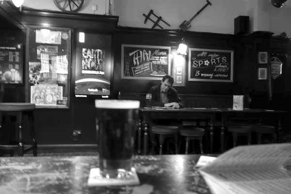 Man in Whitechapel pub, London 2015.