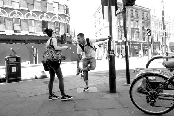 People. Junction of Bethnal Green Road and Brick Lane, London 2015