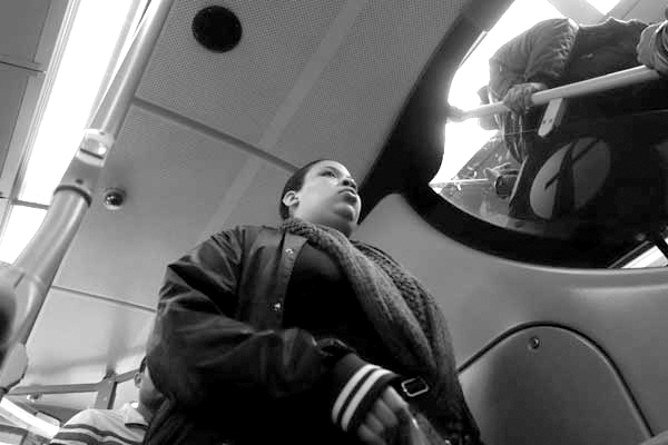 Going up the stairs. On the 25 bus. East London 2015.