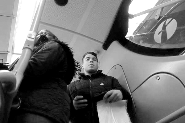 Young man. On the 25 bus. East London 2015.