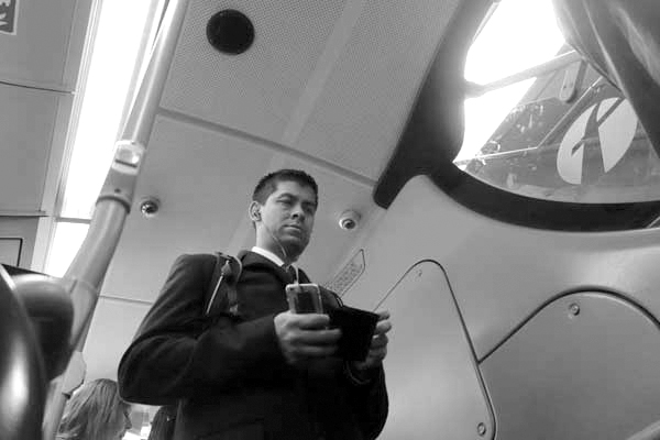 Man. On the 25 bus. East London 2015.