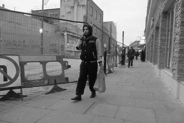 Man with hood. Osborn Street, East London 2016.