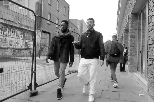 Two young men. Osborn Street, East London 2016.
