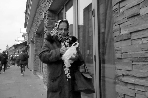 Woman in headscarf. Osborn Street, East London 2016.