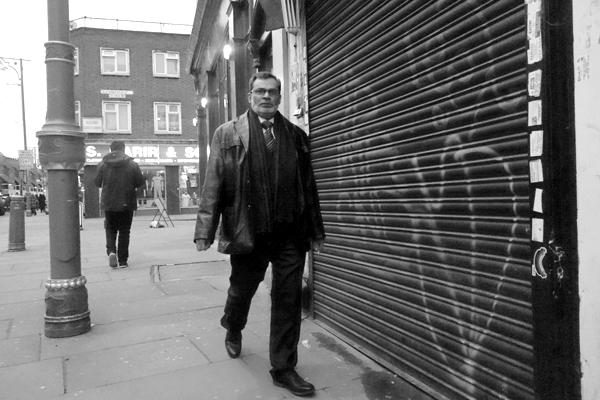 Man with glasses. Osborn Street, East London 2016.