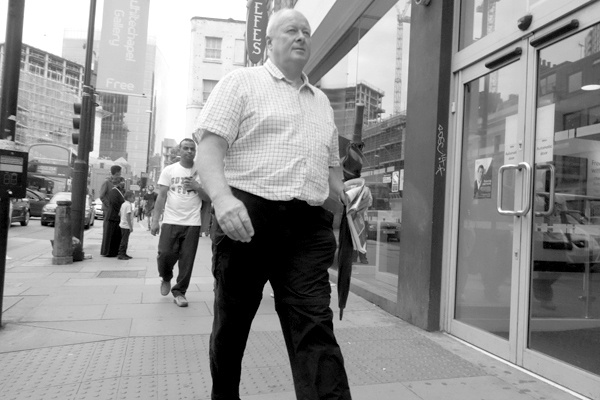 Man walking. Whitechapel, London 2015.