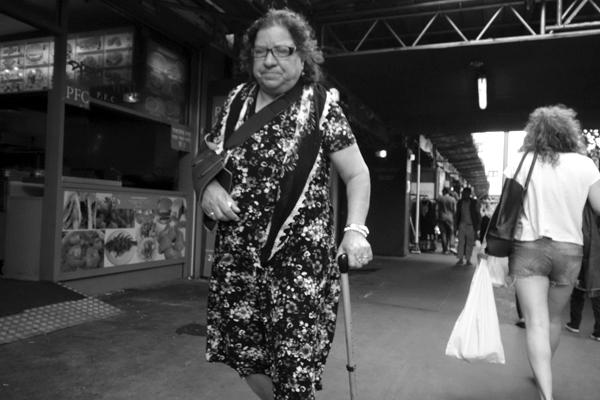 Woman with walking stick. Whitechapel, London 2013.