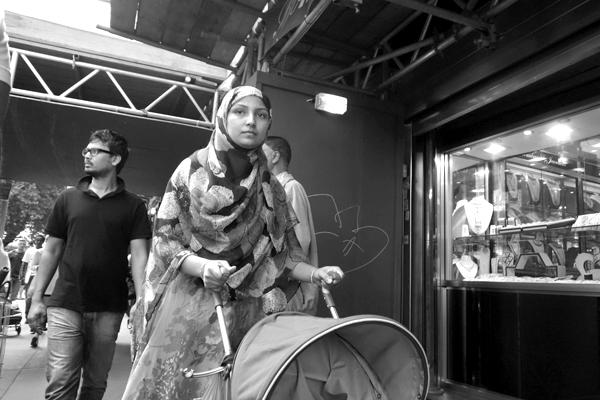 Woman with push chair. Whitechapel, London 2013.