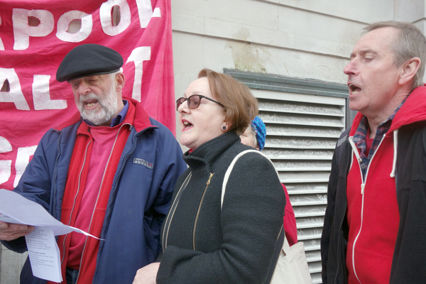 Singing a protest to save the NHS, Liverpool 2017.