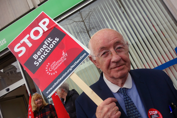 A member of the Merseyside Pensioners Association protesting outside the Job Centre. Liverpool 2017.