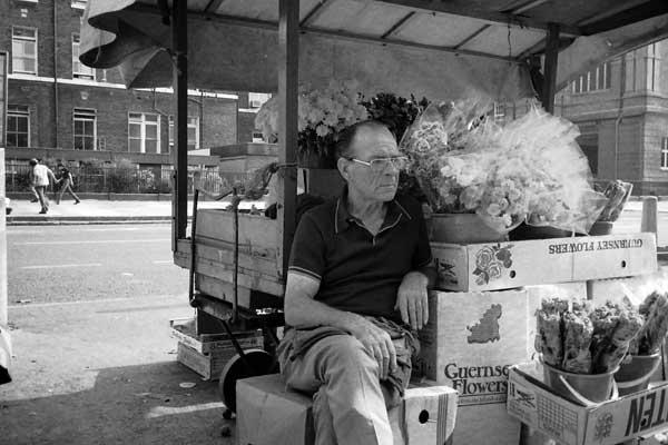 Selling flowers. Whitechapel, London 1986.