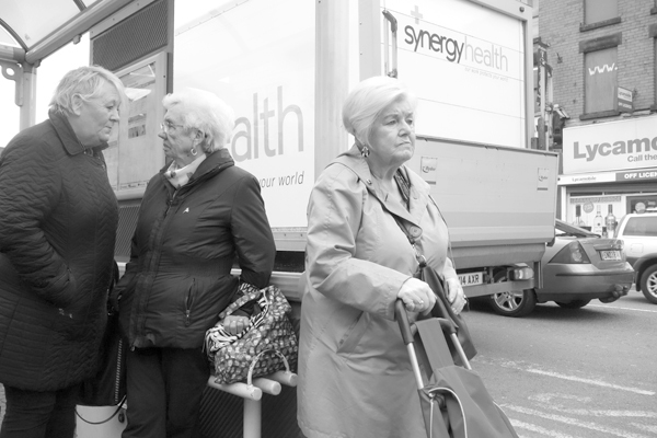 Women at a bus stop. Picton Road, Liverpool 2017.