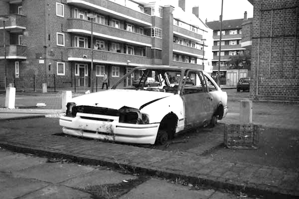 Wrecked car. Hanbury Street, East London 1998.