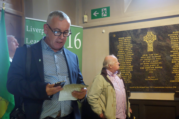 Seamus Murphy reads out the names of the men and women who fought.