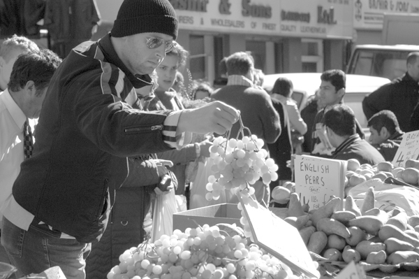 Buying grapes. Brick Lane market 2003.