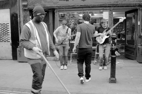 Street cleaner & musicians. Brick Lane 2007.