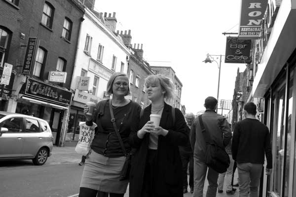 Conversation in Brick Lane. East London 2016.