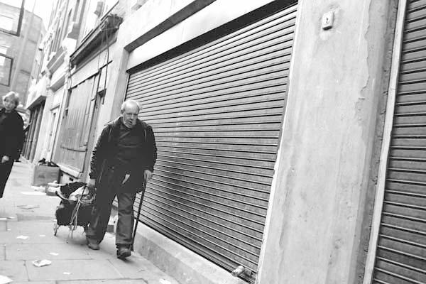 Man with a walking stick. Brick Lane 1984.