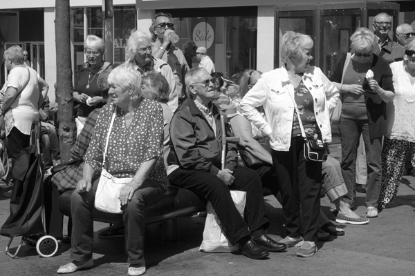 Bus users waiting for the demo to begin. Queens Square, Liverpool 2017.