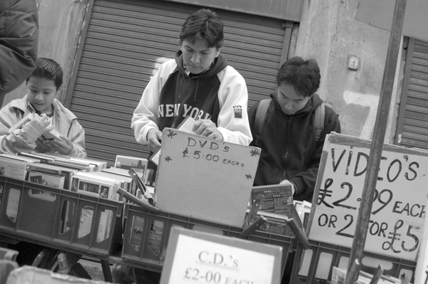 Spicer's record, video, DVD & CD stall. Cheshire Street. East London 2003.