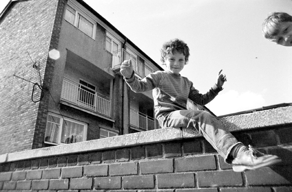 Child on a wall. Liverpool 8 1979.