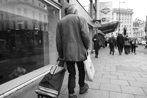 Man with a shopping trolley. Liverpool 2017.