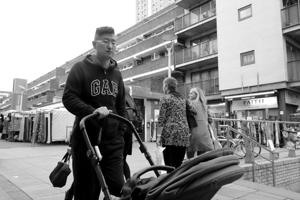Man with a pushchair. Watney Market. East London 2017.