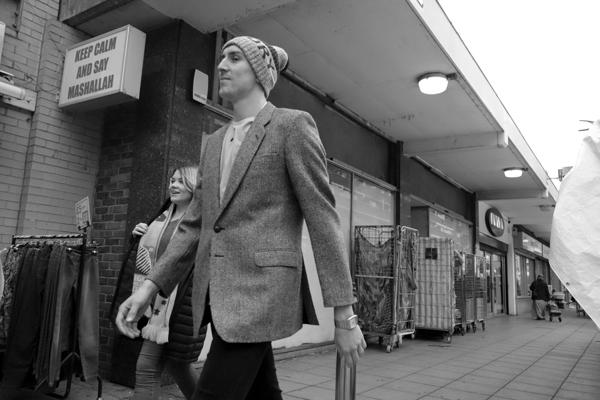 Man with a woolen hat. Watney Market. East London 2017.