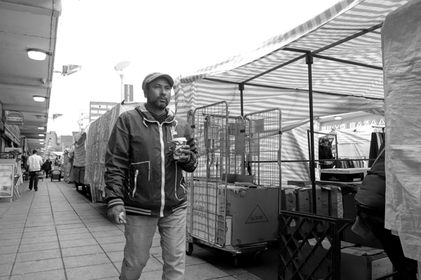 Man with a drink. Watney Market. East London 2017.