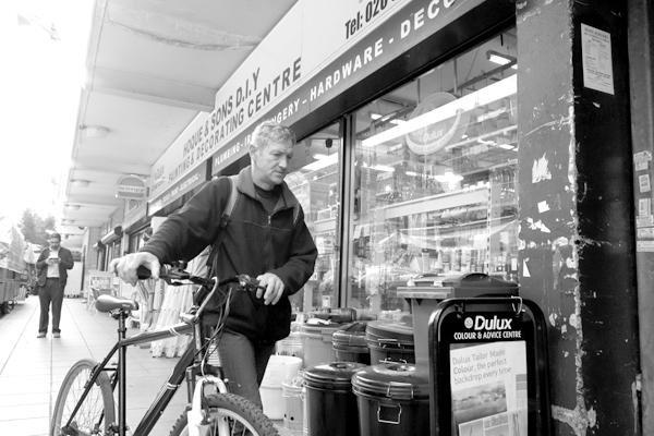 Man with a bicycle. Watney Market. East London 2017.