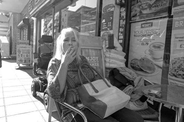 Cigarette break. Watney Market. East London 2017.